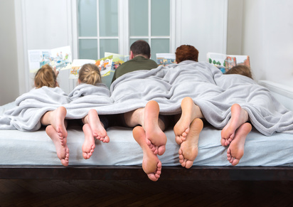 Feet of a family in bed ,
